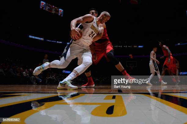 Mason Plumlee of the Denver Nuggets handles the ball against the Portland Trail Blazers on April 9 2018 at the Pepsi Center in Denver Colorado NOTE...