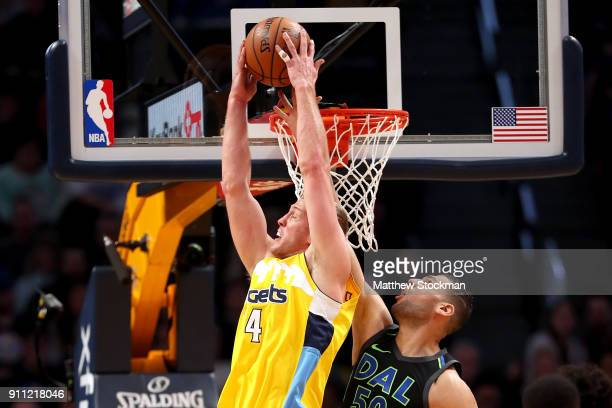 Mason Plumlee of the Denver Nuggets is blocked going to the basket by Salah Mejri of the Dallas Mavericks at the Pepsi Center on January 27 2018 in...