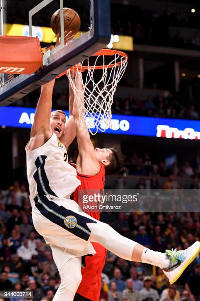 Mason Plumlee of the Denver Nuggets is fouled by Zach Collins of the Portland Trail Blazers during the second half of the Nuggets' 8882 win on Monday...