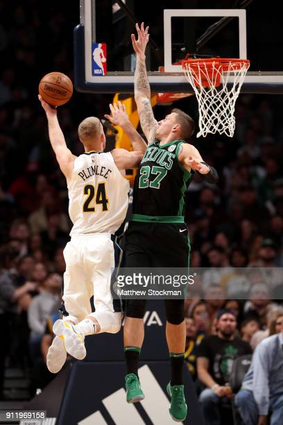Mason Plumlee of the Denver Nuggets puts up a shot against Daniel Theis of the Boston Celtics at the Pepsi Center on January 29 2018 in Denver...