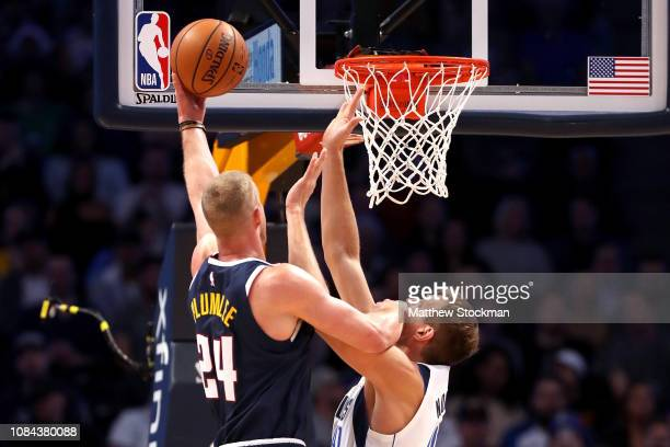 Mason Plumlee of the Denver Nuggets puts up a shot against Dirk Nowitzki of the Dallas Mavericks at the Pepsi Center on December 18 2018 in Denver...