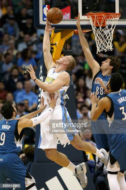 Mason Plumlee of the Denver Nuggets puts up a shot against Ricky Rubio Nemanja Bjelica and KarlAnthony Towns of the Minnesota Timberwolves at the...