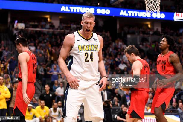 Mason Plumlee of the Denver Nuggets reacts to getting fouled by Zach Collins of the Portland Trail Blazers during the second half of the Nuggets'...