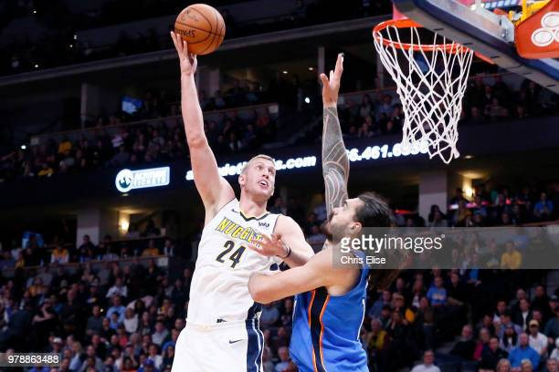 Mason Plumlee of the Denver Nuggets shoots the ball against the Oklahoma City Thunder on November 9 2017 at Pepsi Center in Denver Colorado NOTE TO...