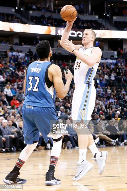 Mason Plumlee of the Denver Nuggets shoots the ball against the Minnesota Timberwolves on February 15 2017 at the Pepsi Center in Denver Colorado...