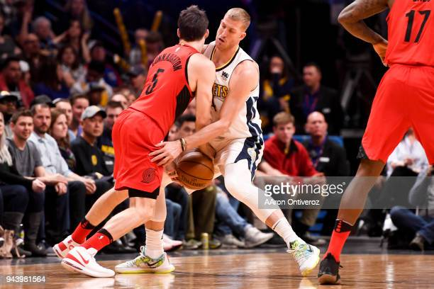 Mason Plumlee of the Denver Nuggets steals the ball from Pat Connaughton of the Portland Trail Blazers during the first half on Monday April 9 2018