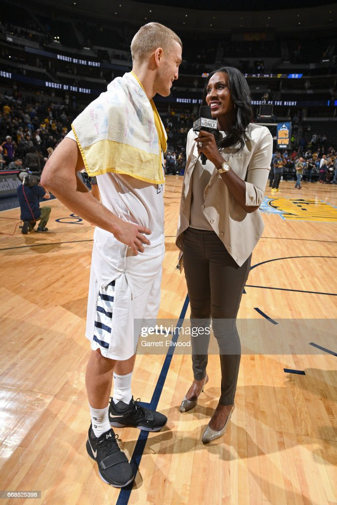 Mason Plumlee #24 of the Denver Nuggets talks with former WNBA player Lisa Leslie after the game against the Los Angeles Lakers on March 13, 2017 at the Pepsi Center in Denver, Colorado.