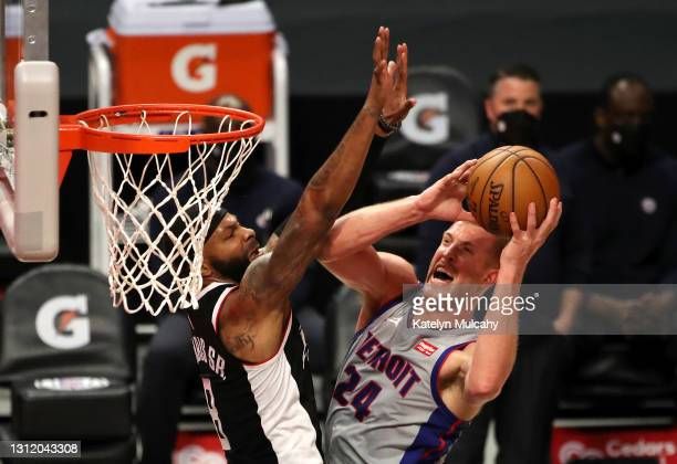 Mason Plumlee of the Detroit Pistons drives to the basket against Marcus Morris Sr. #8 of the Los Angeles Clippers during the third quarter at...