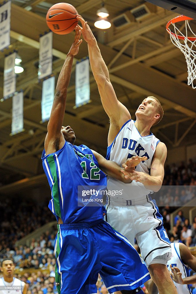 Mason Plumlee #5 of the Duke Blue Devils blocks a shot by Eric McKnight #12 of the Florida Gulf Coast Eagles at Cameron Indoor Stadium on November 18, 2012 in Durham, North Carolina. Duke defeated Florida Gulf Coast 88-67.