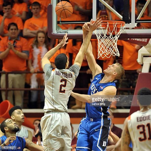 Mason Plumlee of the Duke Blue Devils blocks a shot by Joey Van Zegere of the Virginia Tech Hokies at Cassell Coliseum on February 21 2013 in...