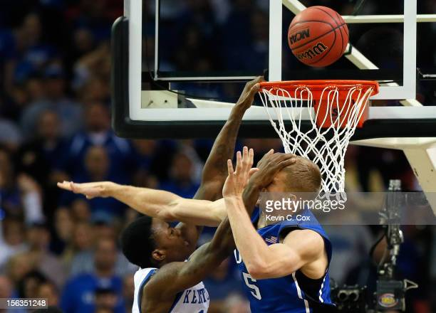 Mason Plumlee of the Duke Blue Devils defends the basket against Archie Goodwin of the Kentucky Wildcats during the 2012 State Farm Champions Classic...