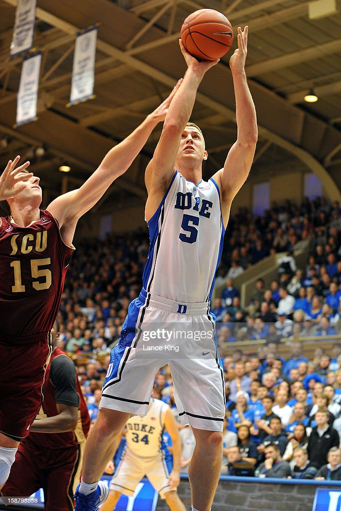 Mason Plumlee #5 of the Duke Blue Devils puts up a shot against Marc Trasolini #15 of the Santa Clara Broncos at Cameron Indoor Stadium on December 29, 2012 in Durham, North Carolina. Duke defeated Santa Clara 90-77.