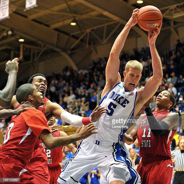 Mason Plumlee of the Duke Blue Devils rebounds against the WinstonSalem State Rams at Cameron Indoor Stadium on November 1 2012 in Durham North...