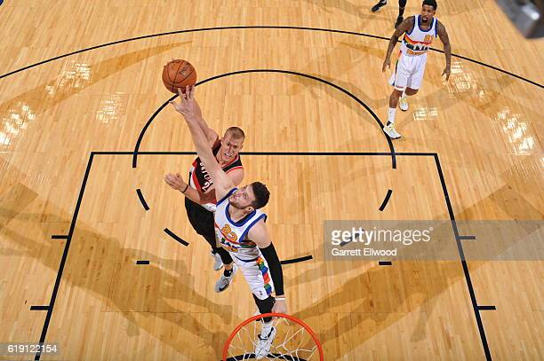 Mason Plumlee of the Portland Trail Blazers shoots the ball against the Denver Nuggetson October 29 2016 at the Pepsi Center in Denver Colorado NOTE...