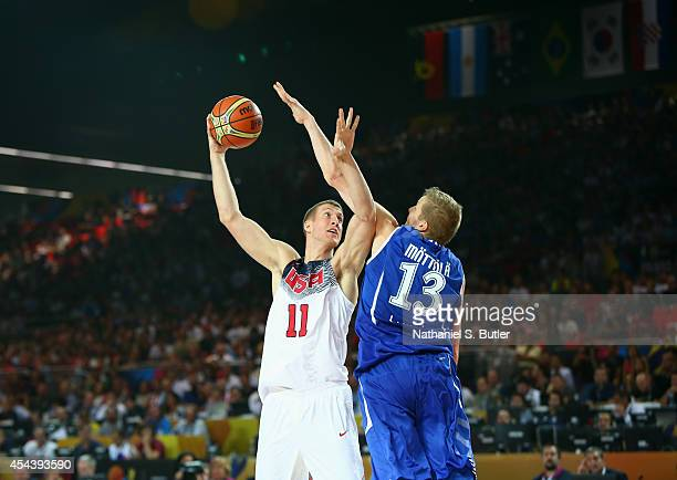Mason Plumlee of the USA Basketball Men's National Team goes up against Hanno Möttölä of the Finland Basketball Men's National Team during the 2014...