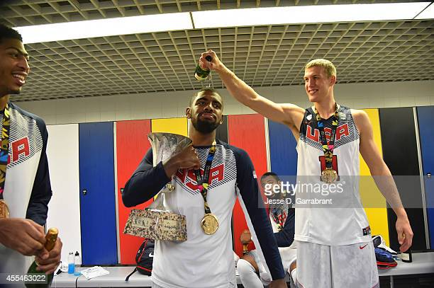 Mason Plumlee pours champagne on Kyrie Irving of the USA Men's National Team as they celebrates in the locker room after defeating the Serbia...