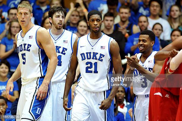 Mason Plumlee Ryan Kelly Amile Jefferson and Tyler Thornton of the Duke Blue Devils react following a play against the WinstonSalem State Rams at...