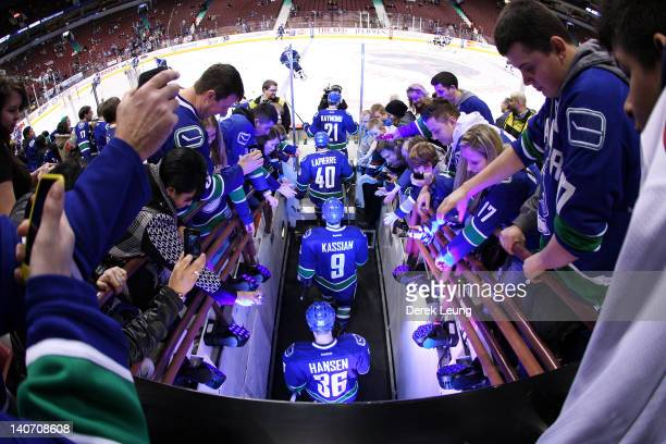 Mason Raymond Maxim Lapierre Zack Kassian and Jannik Hansen of the Vancouver Canucks walk out for warmups before their game against the St Louis...