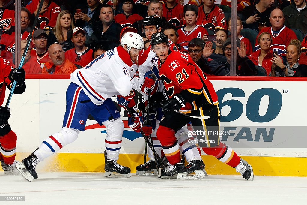 Mason Raymond #21 of the Calgary Flames skates against Alex Galchenyuk #27 of the Montreal Canadiens during an NHL game at Scotiabank Saddledome on October 30, 2015 in Calgary, Alberta, Canada.