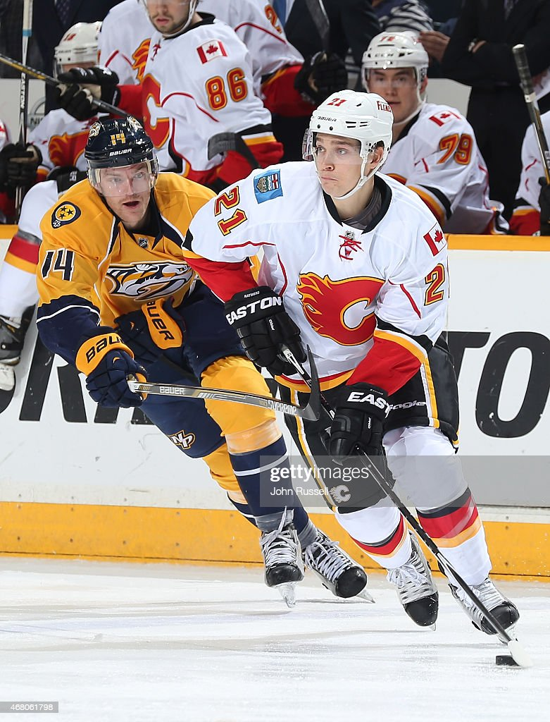 Mason Raymond #21 of the Calgary Flames skates against Mattias Ekholm #14 of the Nashville Predators during an NHL game at Bridgestone Arena on March 29, 2015 in Nashville, Tennessee.