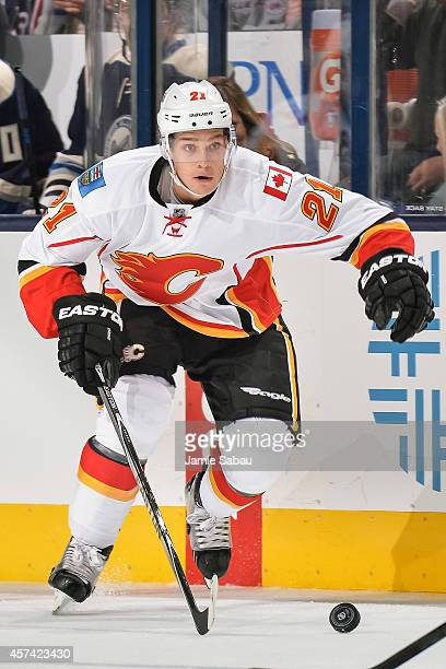 Mason Raymond of the Calgary Flames skates with the puck against the Columbus Blue Jackets on October 17 2014 at Nationwide Arena in Columbus Ohio