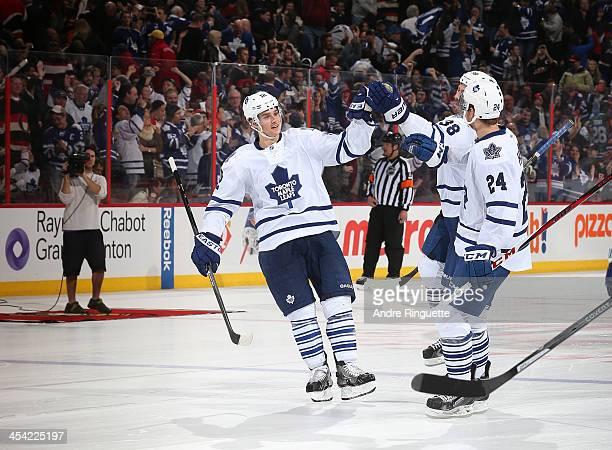 Mason Raymond of the Toronto Maple Leafs celebrates his shootout win against the Ottawa Senators with teammates Frazer McLaren and Peter Holland at...