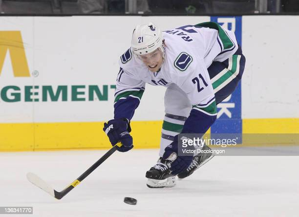 Mason Raymond of the Vancouver Canucks reaches for the puck during the NHL game against the Los Angeles Kings at Staples Center on December 31 2011...