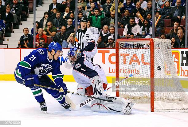 Mason Raymond of the Vancouver Canucks scores a goal in the first period on Steve Mason of the Columbus Blue Jackets during their game at Rogers...