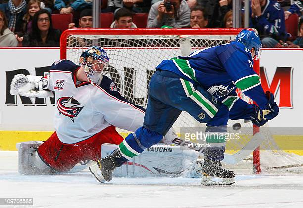 Mason Raymond of the Vancouver Canucks scores on Steve Mason of the Columbus Blue Jackets in the shootout during their game at Rogers Arena on March...