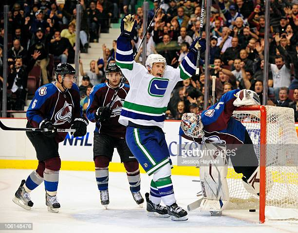 Mason Raymond of the Vancouver Canucks scores the winning goal in over time at Rogers Arena on October 26 2010 in Vancouver British Columbia Canada
