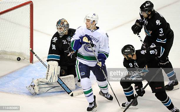 Mason Raymond of the Vancouver Canucks screens goaltender Antti Niemi of the San Jose Sharks in Game Three of the Western Conference Finals during...