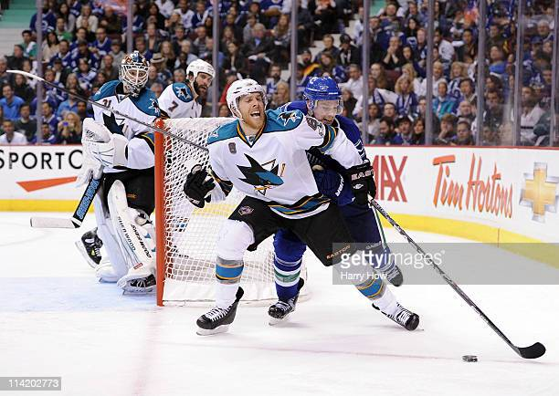 Mason Raymond of the Vancouver Canucks skates after the puck on the forecheck against Joe Pavelski of the San Jose Sharks in Game One of the Western...