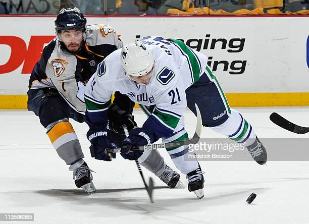 Mason Raymond of the Vancouver Canucks skates against Jonathon Blum of the Nashville Predators in Game Three of the Western Conference Semifinals...