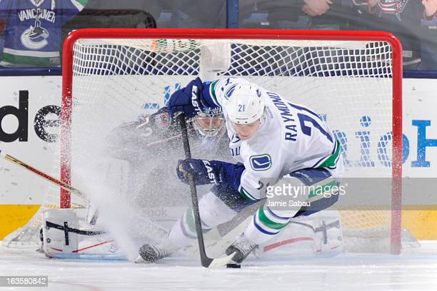Mason Raymond of the Vancouver Canucks stops and spins in front of goaltender Sergei Bobrovsky of the Columbus Blue Jackets before scoring the game...