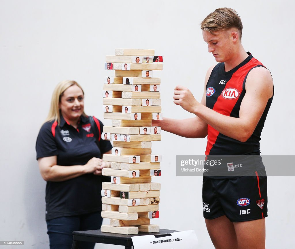 Mason Redman of Essendon players a game of Jenga before an Essendon Bombers team photo session at The Hangar on February 6, 2018 in Melbourne, Australia.