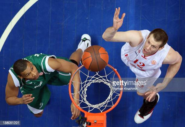 Mason Rocca #12 of EA7 Emporio Armani Milan competes with Kelly McCarthy #21 of Unics Kazan during the 20112012 Turkish Airlines Euroleague TOP 16...