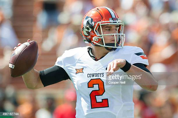 Mason Rudolph of the Oklahoma State Cowboys drops back to pass against the Texas Longhorns during the 1st quarter on September 26 2015 at Darrell K...