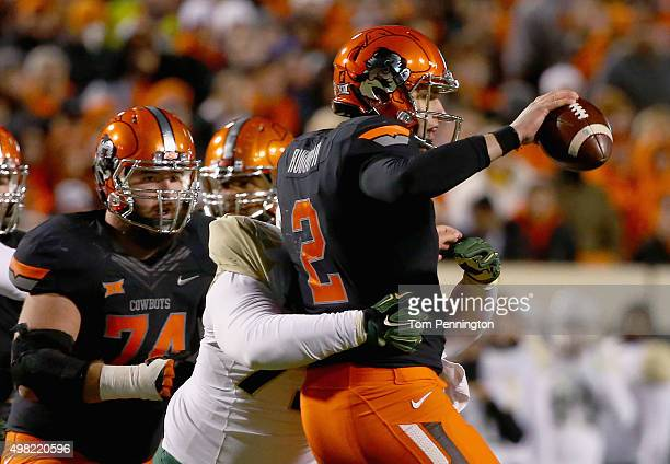 Mason Rudolph of the Oklahoma State Cowboys is sacked by Andrew Billings of the Baylor Bears in the second quarter at Boone Pickens Stadium on...