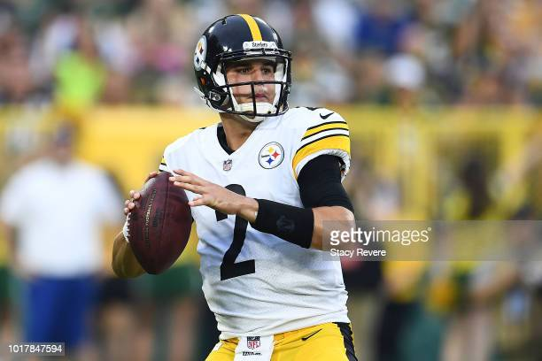 Mason Rudolph of the Pittsburgh Steelers drops back to pass during the first quarter of a preseason game against the Green Bay Packers at Lambeau...