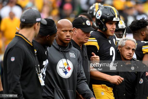 Mason Rudolph of the Pittsburgh Steelers is helped off the field after being knocked out by a hit in the third quarter during the game against the...