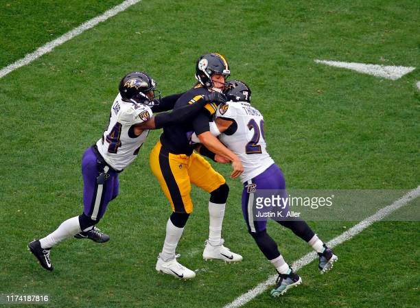 Mason Rudolph of the Pittsburgh Steelers is injured on the play as he is tackled by Earl Thomas and Brandon Carr of the Baltimore Ravens on October 6...