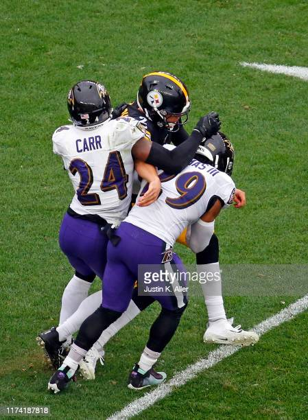 Mason Rudolph of the Pittsburgh Steelers is injured on the play as he is tackled by Earl Thomas and Brandon Carr of the Baltimore Ravens on October...