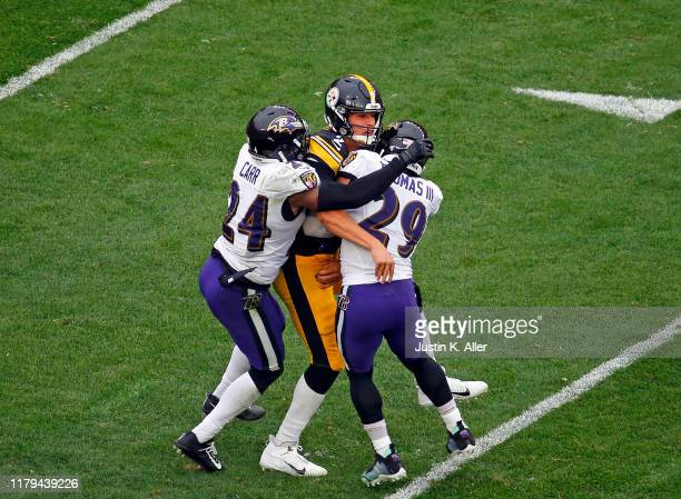 Mason Rudolph of the Pittsburgh Steelers is injured on the play between Earl Thomas and Brandon Carr of the Baltimore Ravens on October 6, 2019 at...