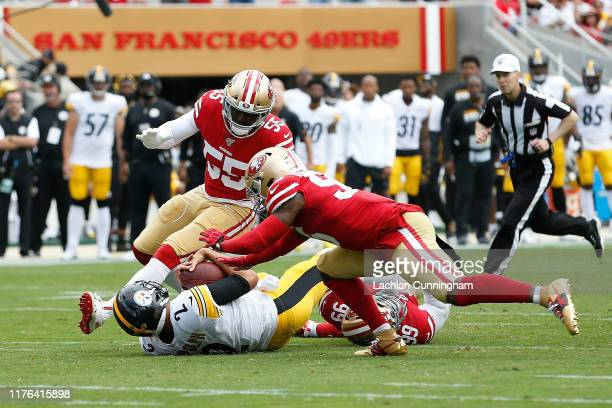 Mason Rudolph of the Pittsburgh Steelers is sacked by DeForest Buckner and Kwon Alexander of the San Francisco 49ers in the first quarter at Levi's...