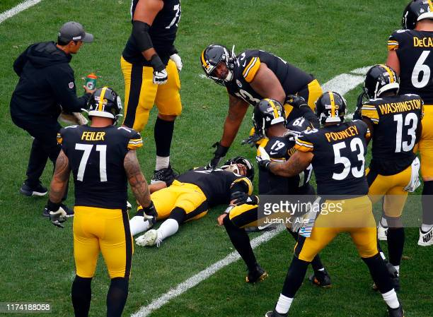 Mason Rudolph of the Pittsburgh Steelers lays on the ground after being injured against the Baltimore Ravens on October 6 2019 at Heinz Field in...