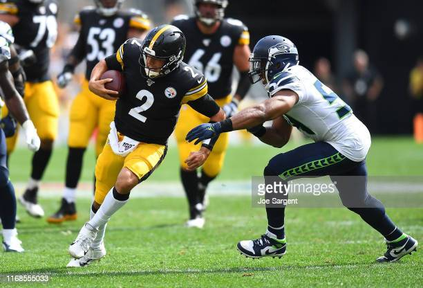 Mason Rudolph of the Pittsburgh Steelers rushes for a first down in front of Bobby Wagner of the Seattle Seahawks during the fourth quarter at Heinz...