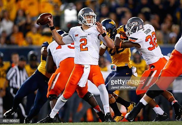 Mason Rudolph of the West Virginia Mountaineers drops back to pass in the first quarter against the Oklahoma State Cowboys during the game at...