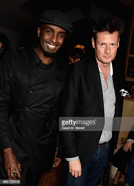 Mason Smillie and Percy Parker attend a VIP preview of LIBRARY a new private members club on St Martins Lane on April 16 2014 in London England