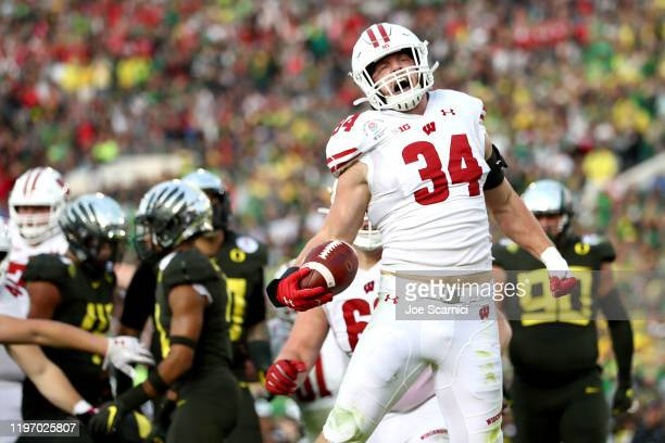Mason Stokke of the Wisconsin Badgers celebrates after scoring a one yard touchdown against the Oregon Ducks during the third quarter in the Rose...