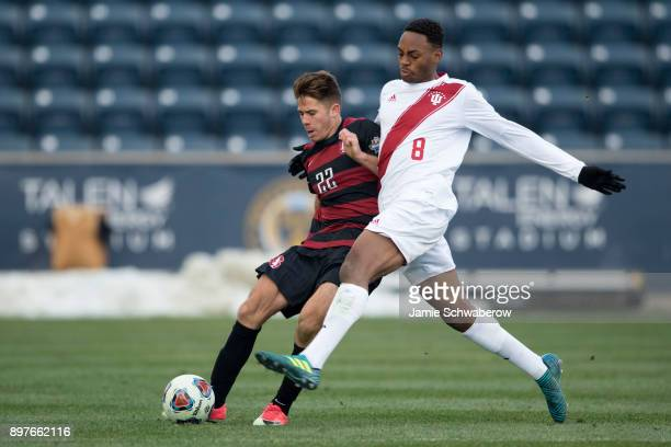 Mason Toye of Indiana University and Logan Panchot of Stanford University battle for the ball during the Division I Men's Soccer Championship held at...